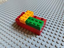 Stacked Lego and Duplo bricks [Wikimedia Commons: https://commons.wikimedia.org/wiki/File:Briques_de_Lego_et_Duplo_empil%C3%A9es_.jpg]